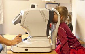 Toddler receiving an eye exam